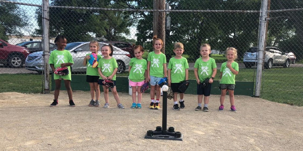 Kids from a t-ball team pose together