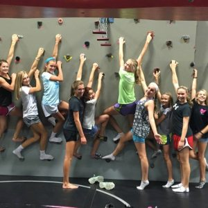 Girls On Rock Wall At The Athletic Training Center