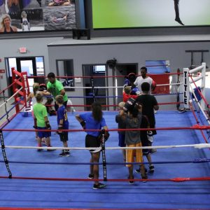 Youth Practicing Boxing At The Athletic Training Center